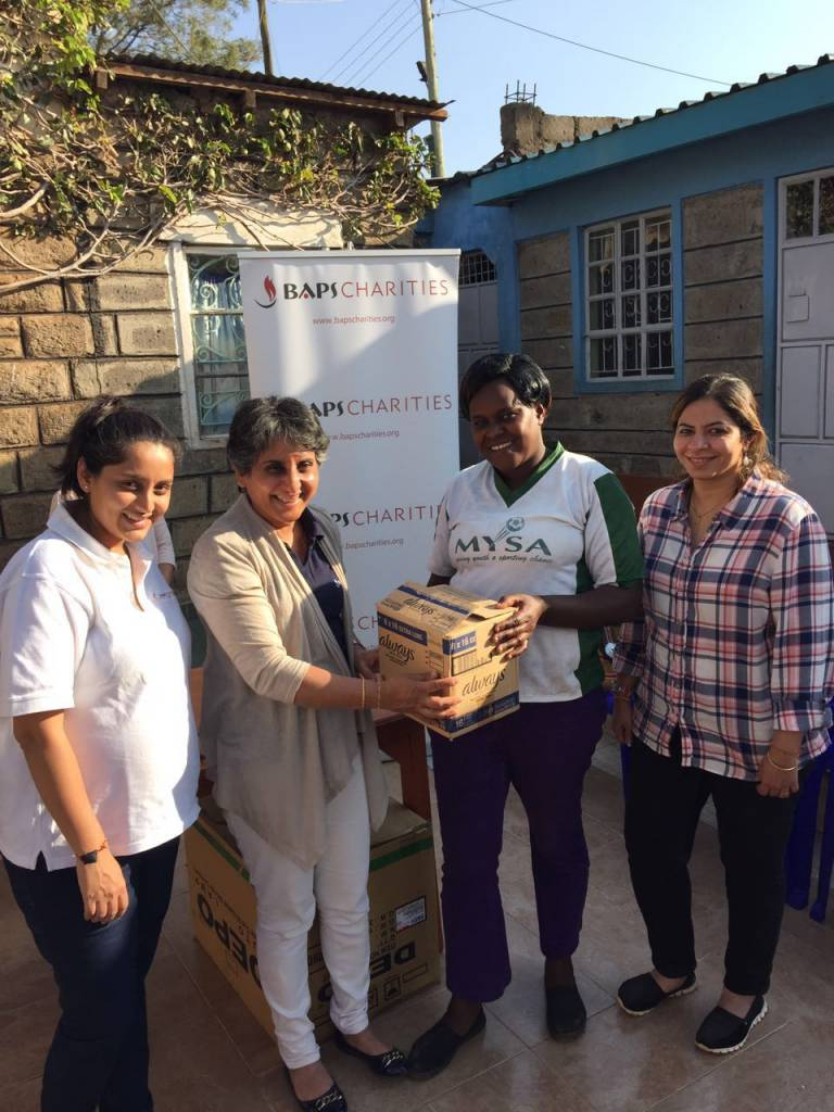 Donating sanitary napkins at Dadas Community Centre