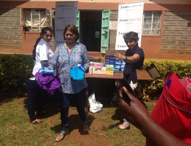 Distributing items at Rafiki AIDS Academy