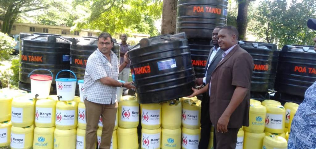 Mr. Jayesh Patel donating water tanks to the Kisumu County officials