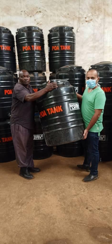 Tank Donations to the Kisumu Health Ministry. Brijesh Patel to Mr. Sila Atena of the ministry